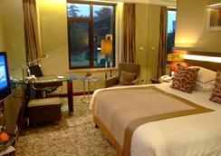 Qingdao Seaview Garden Hotel - Qingdao - Bedroom