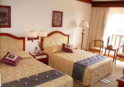 New Angkorland Boutique Hotel - Siem Reap - Bedroom