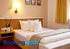 Stadthotel Erding - Erding - Bedroom