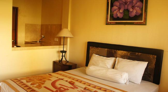 La Mulya Guest House - Kuta - Bedroom