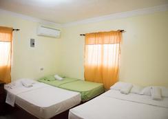 Tropical Island Apartahotel - Santo Domingo - Bedroom
