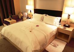 Nanning Winwin Hotel - Nanning - Bedroom