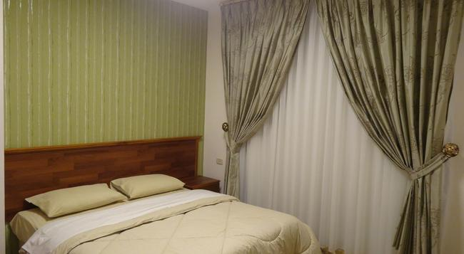 Golden Palace Hotel Apartments - Amman - Bedroom