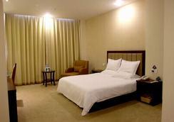 Greentree Inn Yancheng Station Hotel - Yancheng - Bedroom