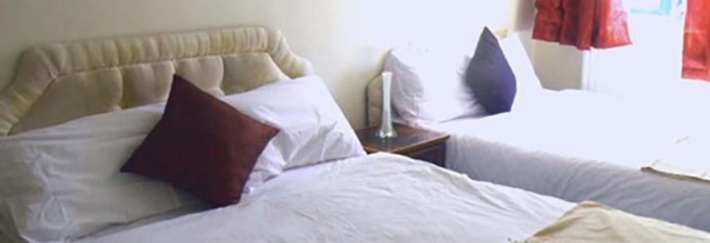 Pacific Inn London Heathrow - Southall - Bedroom