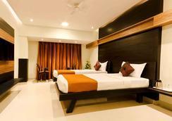 Prajwal By Mango Hotels - Bangalore - Bedroom