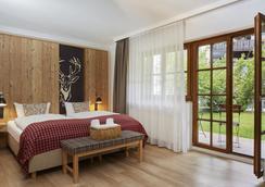 H+ Hotel Alpina Garmisch-Partenkirchen - Garmisch-Partenkirchen - Bedroom