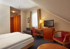 H+ Hotel Lampertheim - Lampertheim - Bedroom