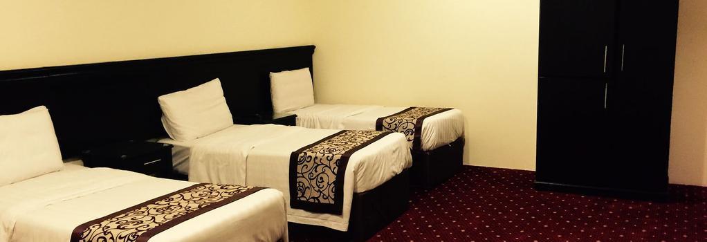 Manazel Alkhair Wa Albaraka Hotel - Mecca - Bedroom