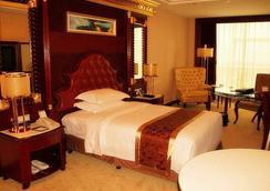 Xiangyang Celebrity City Hotel - Xiangyang - Bedroom