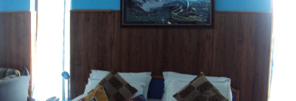Mukteshwar Himalayan Resorts - Mukteshwar - Bedroom