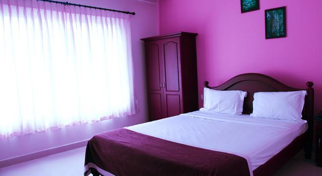 Mintflower Residency - Sultan Bathery - Bedroom