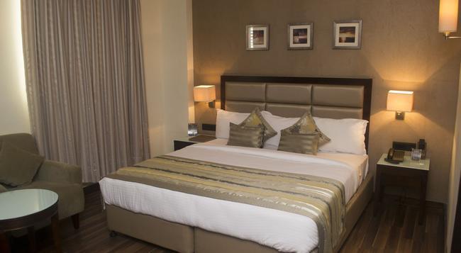 Krios Hotel - Ahmedabad - Bedroom