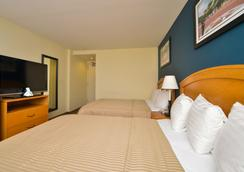 Magnuson Convention Center Hotel - New York - Bedroom