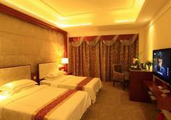 Nan Guo Hotel - Guangzhou - Bedroom