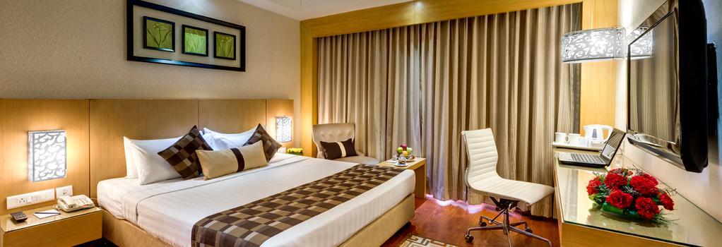 Jameson Inn Shiraz - Kolkata - Bedroom