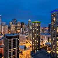 The Westin Seattle Twilight in Seattle featuring the Westin Hotel Seattle, in Seahawks colors, looking South to the Seattle skyline