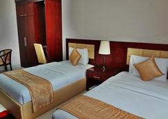 Hala Inn Hotel Apartments - Ajman - Bedroom