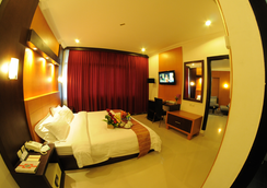 Swarna Dwipa Hotel - Palembang - Bedroom