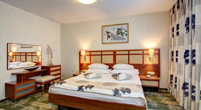 Izmailovo Alpha Hotel - Moscow - Bedroom
