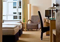 Sorat Insel-Hotel Regensburg - Regensburg - Bedroom