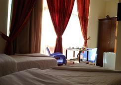 Qasr Al-Azziziah Hotel - Mecca - Bedroom