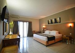 Taman Rosani Hotel - Kuta - Bedroom