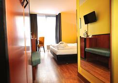 Golden Leaf Hotel Stuttgart Airport & Messe - Stuttgart - Bedroom