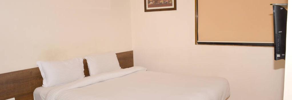 Budget Inn Palm Regency - Vapi - Bedroom